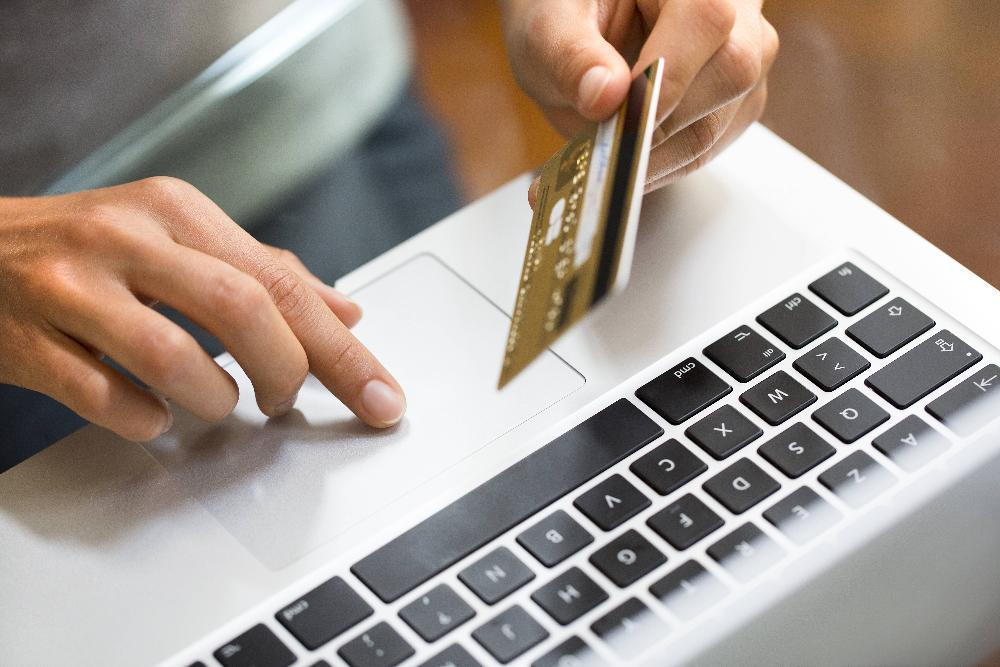 paying with credit card on laptop