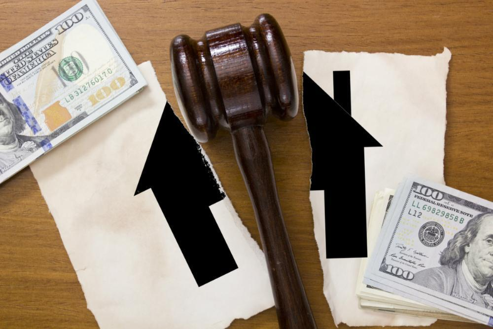 Gavel surrounded by paperwork and money | Schaumburg IL Attorney
