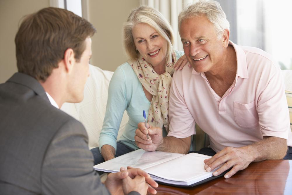 Estate Planning | Older Couple Signing Paperwork