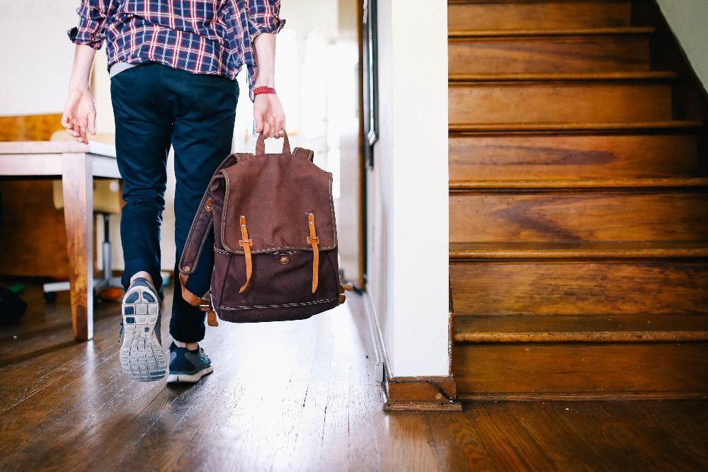 man carrying backpack | Attorney Schaumburg IL