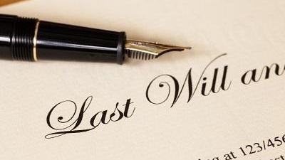 last will and testament paperwork with pen on top