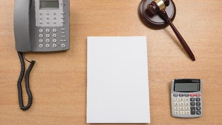 Desk with phone paper and gavel | Spousal Maintenance in Schaumburg IL