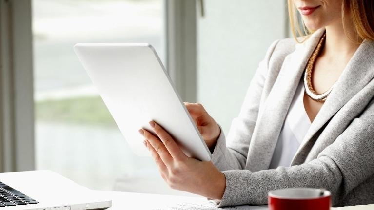 Woman holding tablet | Divorce Lawyer Schuamburg IL