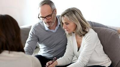 man and woman working on estate planning