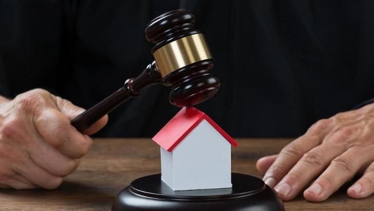 Gavel on replica house | Property Tax Exemptions Schaumburg