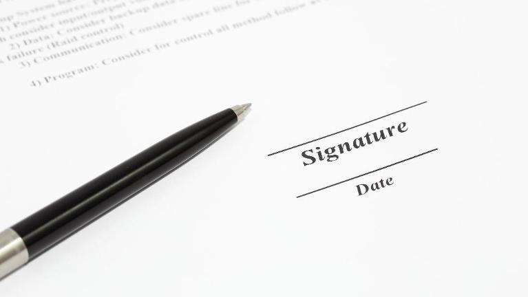 Paper with signature area | Real Estate Law Hoffman Estates IL