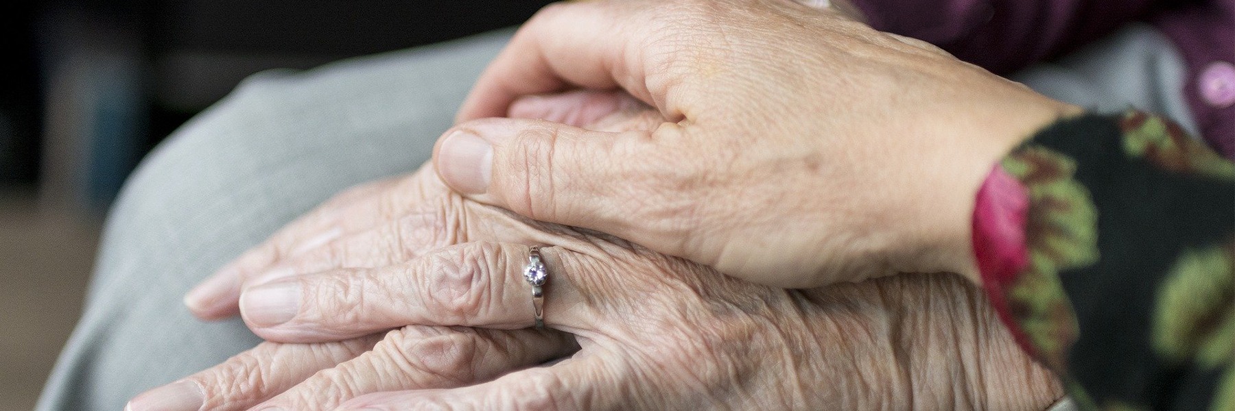 close up of hands of an elderly couple